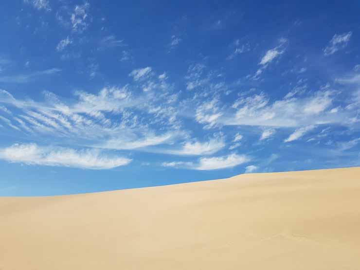 Explorar as Dunas do Santinho e praias próximas